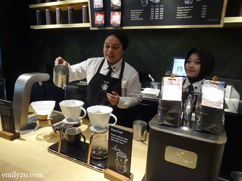 5. Starbucks Ambassador Ayesha brews coffee using the Pour-Over technique, assisted by Sarah