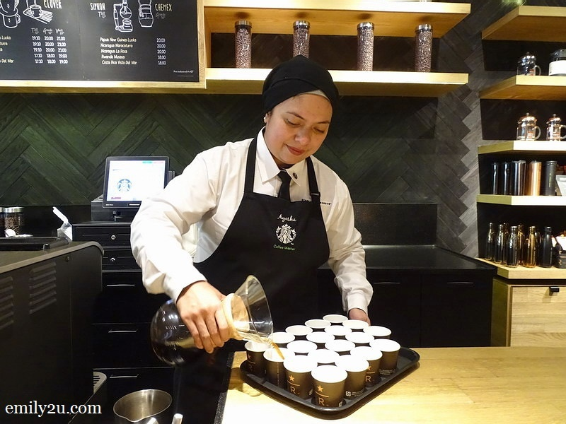 7. Ayesha prepares small cups of coffee for us to taste