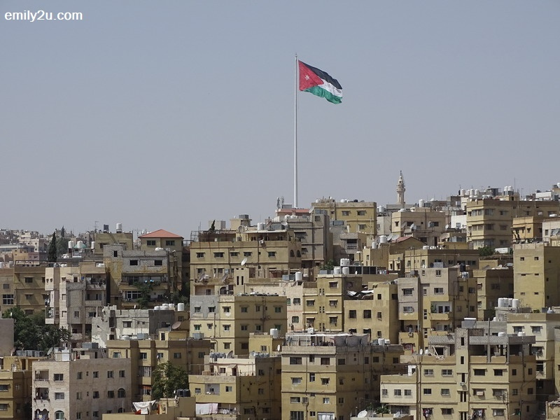 1. an unobstructed view of Raghadan Flagpole, the largest flag and tallest flagpole in the world, from Amman Citadel