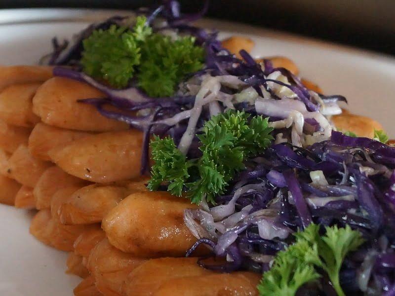 12. chicken sausage with braised cabbage