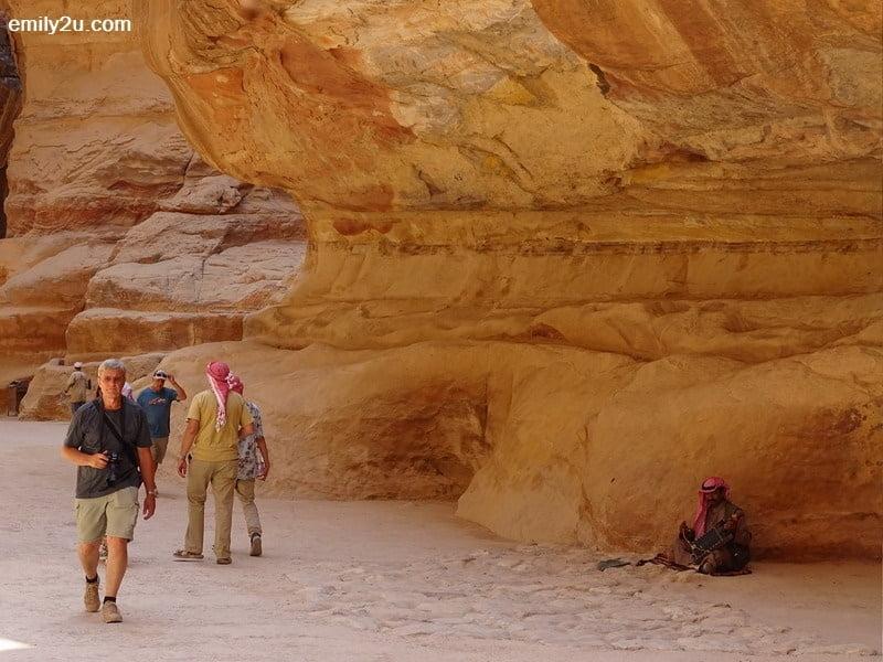 13. a busker in Petra