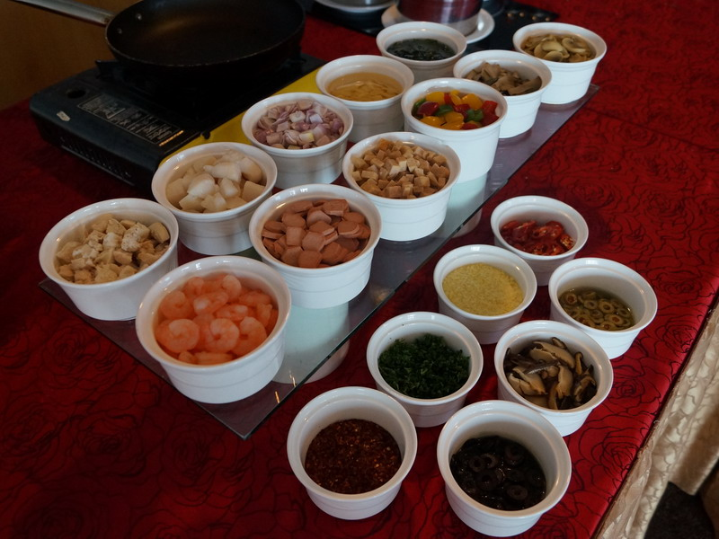 23. condiments available at the Gourmet Pasta Station