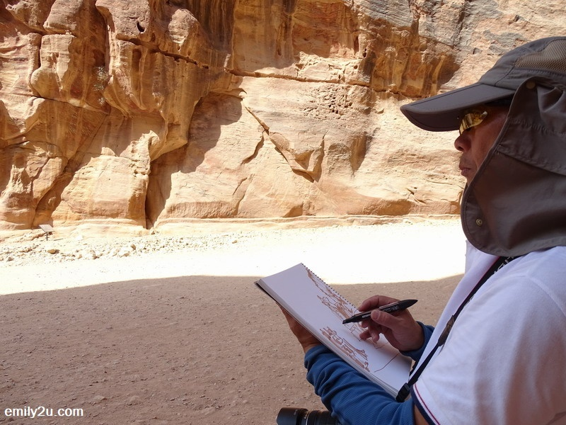 24. a visitor from Hong Kong seals his memory of Petra with a sketch