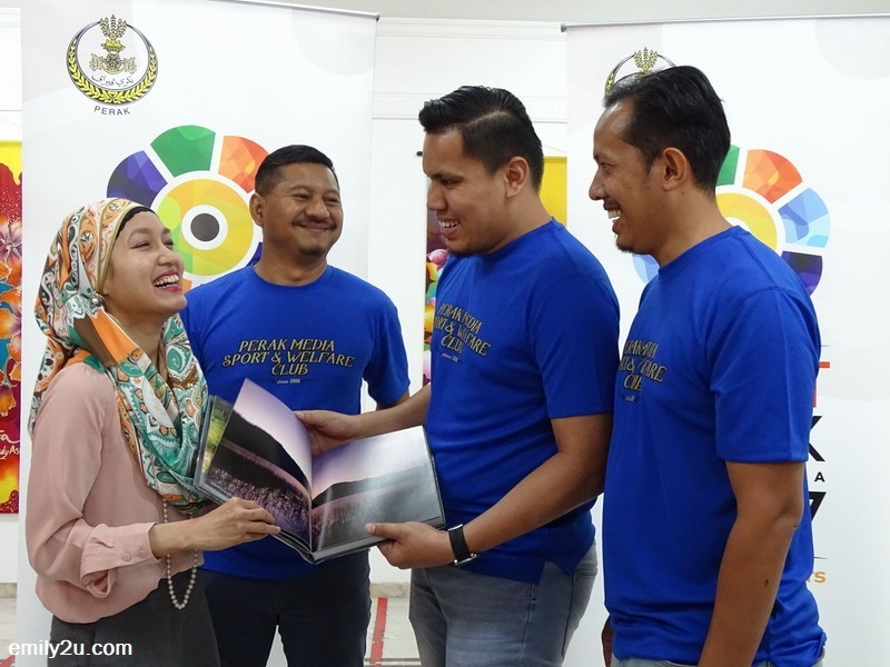 8. a hardcover book on Royal Belum as a gift to the Embassy, presented by an officer from Tourism Perak, Adnan Sulaiman (2nd from R)
