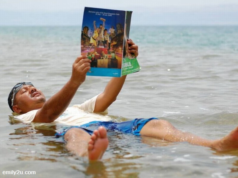 9. KSKMP adviser-cum-delegation leader, Datuk Akmar Hisham Mokhles reads a magazine while floating in the Dead Sea