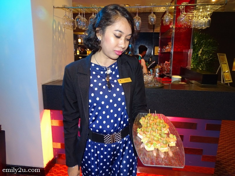 8. Ratiya, Impiana Hotel Ipoh Sales Executive, helps to serve the guests