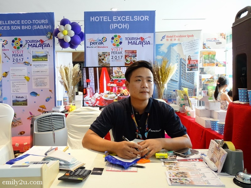 a staff manning the booth of Hotel Excelsior, Ipoh