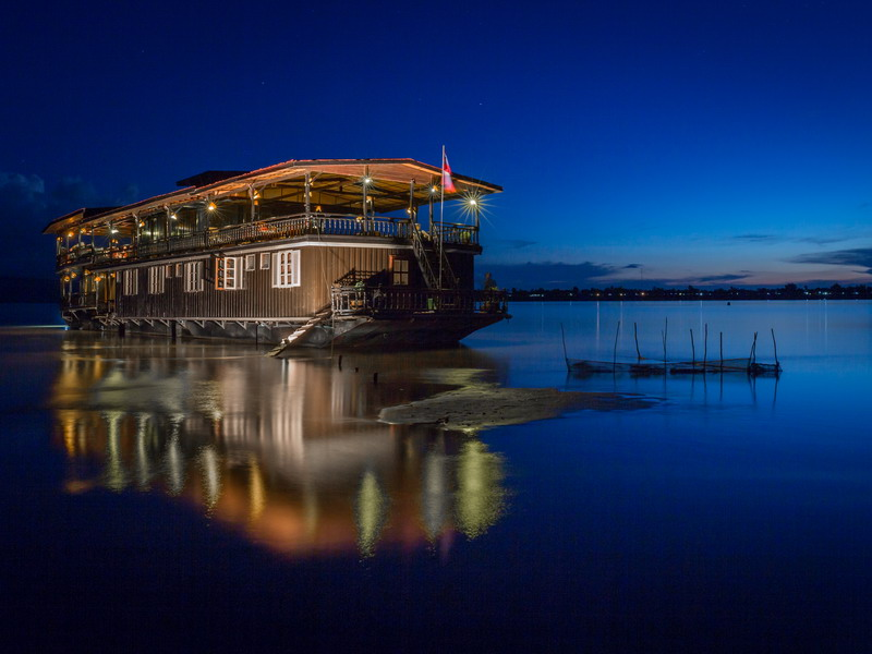 The Vat Phou boat, a floating hotel cruising along the Mekong River, Southern Laos