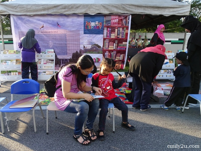 3. mother and daughter make use of the mobile library