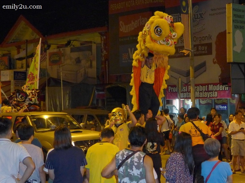 6. lion dance through the streets of Ipoh