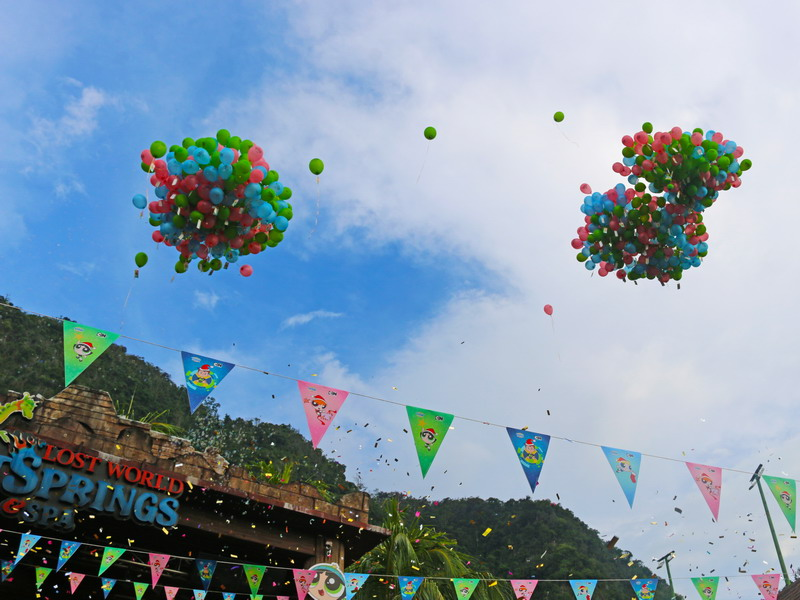 2. balloons with Lost World POW Holidays in the air