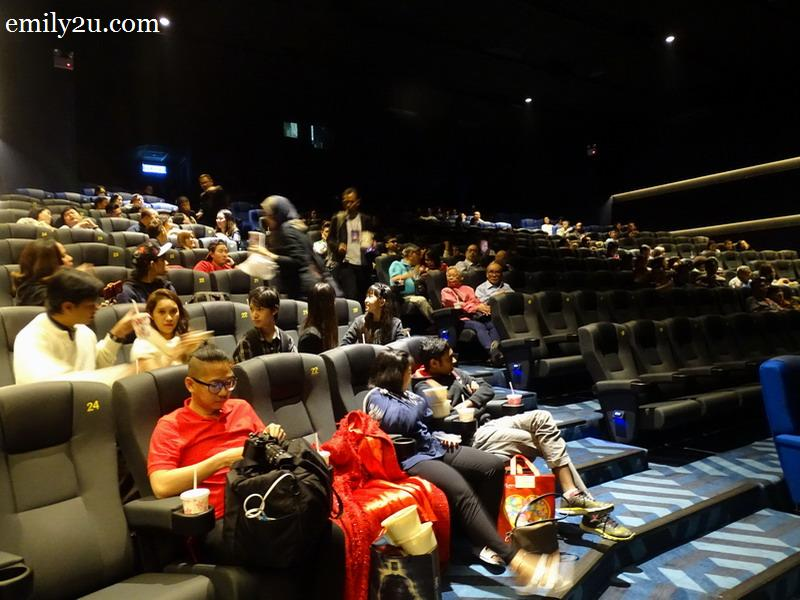 6. the cinema is filling up with invited guests