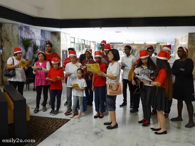 1. carolling by the choir from Our Mother of Perpetual Help Church, Ipoh