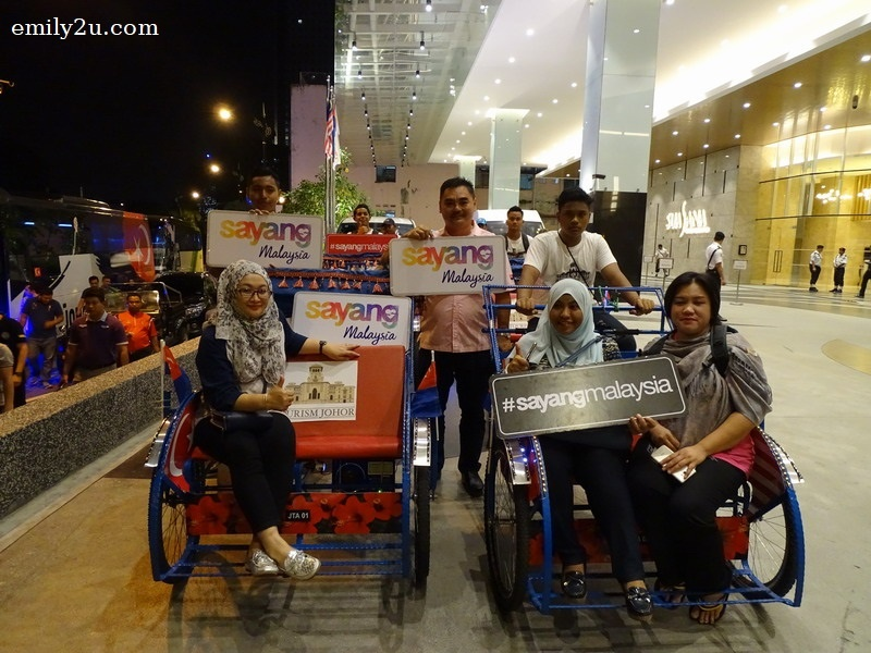 1. before the trishaw ride - Deputy Secretary General (Tourism) for MOTAC Puan Nor Yahati binti Awang (seated left) and Director Ministry of Tourism and Culture Malaysia Johor Office  Puan Magdlane Tuborng Melai (seated right)