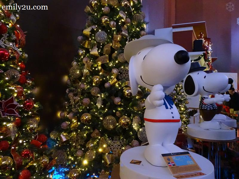 11. some of the Snoopy figurines in various national costumes