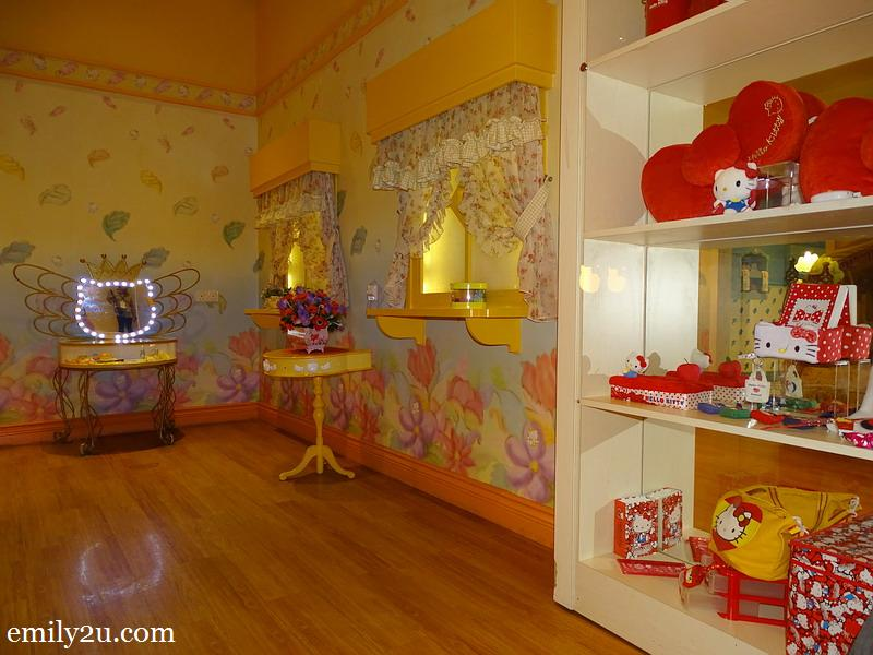 12. Hello Kitty House with shelves filled with Hello Kitty collectibles