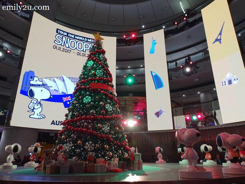 15. Snoopy figurines surround the 20-foot tall Christmas tree