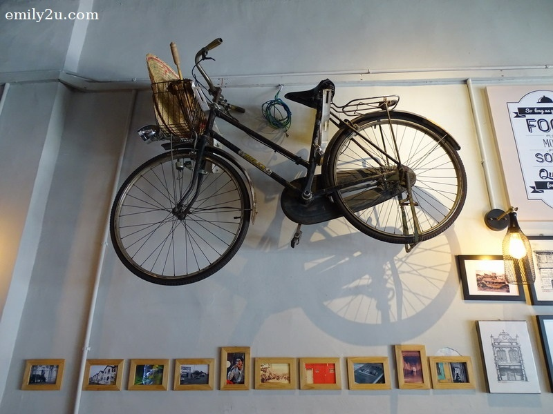 3. an old bicycle hangs on the wall