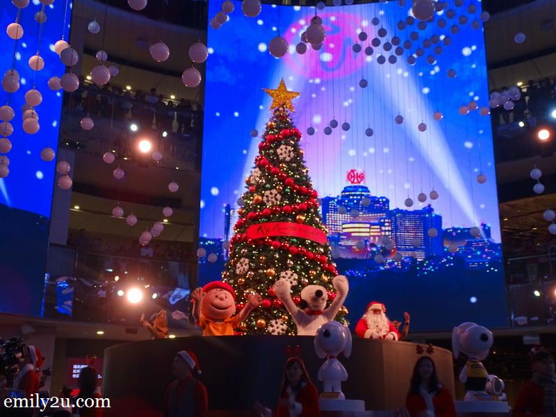 5. a 20-foot tall Christmas tree rises from beneath the stage, accompanied by the Peanuts gang, Santa Claus and his elves