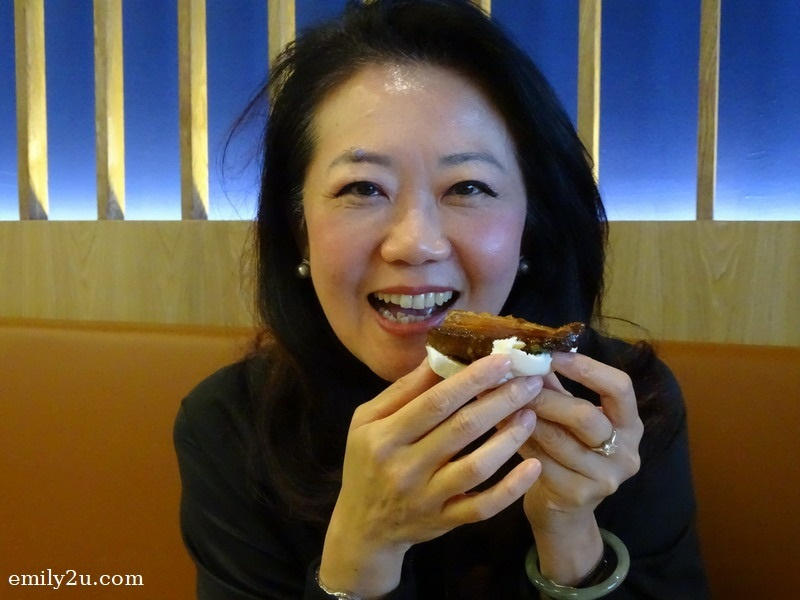 8. Ms. Katherine Chew (Resorts World Genting Vice President Resort Communications & Public Relations) about to savour her mantou with pork belly and yam