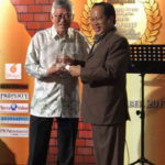 Peter Chan receives one of two awards from Deputy Minister of International Trade and Industry