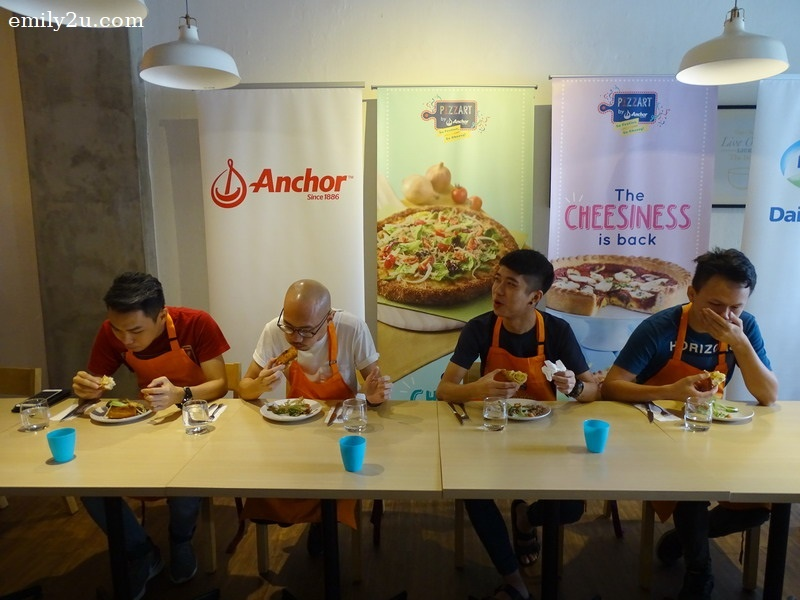 13. pizza eating competition in progress at Mustard Sandwich House