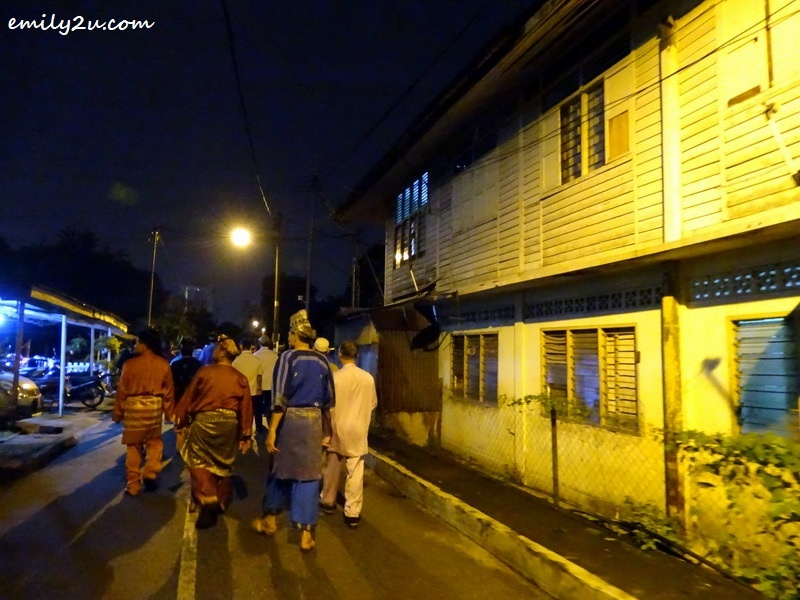 5. walking along the alley in traditional costumes