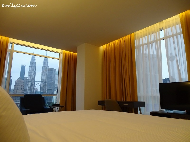 a view of both Petronas Twin Towers and KL Tower from TAMU Hotel & Suites, Kuala Lumpur