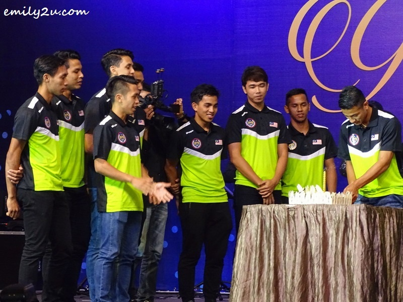 11. teammates of Firhan Ashari (R) help him celebrate his birthday