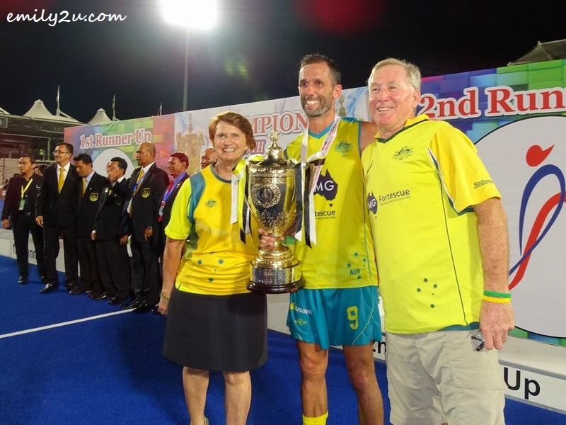 9. Birthday Boy, Mark Knowles, and his parents take a photo with the Sultan Azlan Shah Cup - his fifth title and final outing at the tournament prior to retirement from international hockey