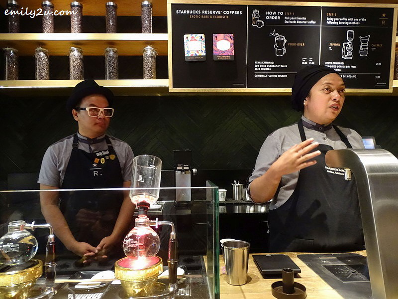 3. Starbucks Ambassador Ayesha (R) explains about the two new coffee brews while Assistant Store Manager Omar Shaari (L) looks on, as the siphon works its magic