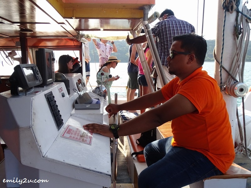 4. captain busy navigating the catamaran