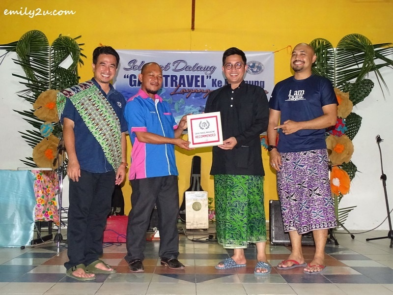 17. Ketua Kampung Layang-Layangan En. Faizal Bin Hj. Lakat (2nd from L) receives an appreciation plaque from Gaya Travel Magazine, represented by Nuar Md. Diah (2nd from R) and Ed Junaidi (R), as Director of Tourism, Cultural and Arts Department of Labuan Corporation, En. Mahathir Hamid (L) looks on