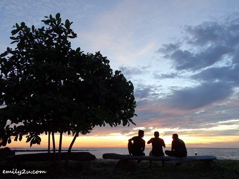 18. three buddies enjoy the sunset on the private beach of Palm Beach Resort & Spa