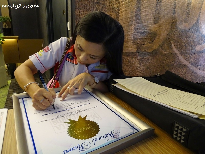 11. official from The Malaysia Book of Records, Ms. Lee Pooi Leng, certifies the record