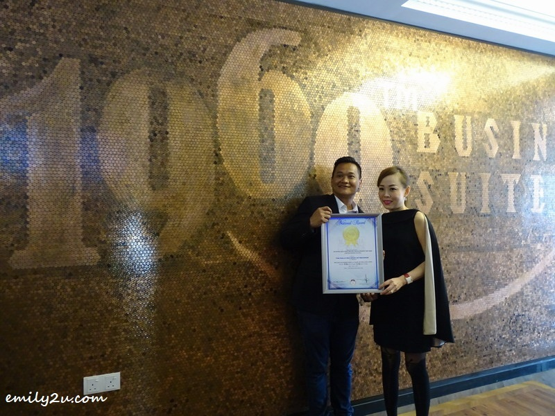 12. Datin Kelly Yang (R) and Mr. Wong Mun Hong (L) with the certificate from Malaysia Book of Records