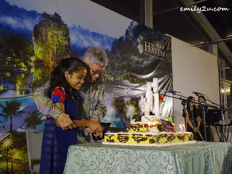 20. Mr. Peter Chan cuts his birthday cake with his god-daughter