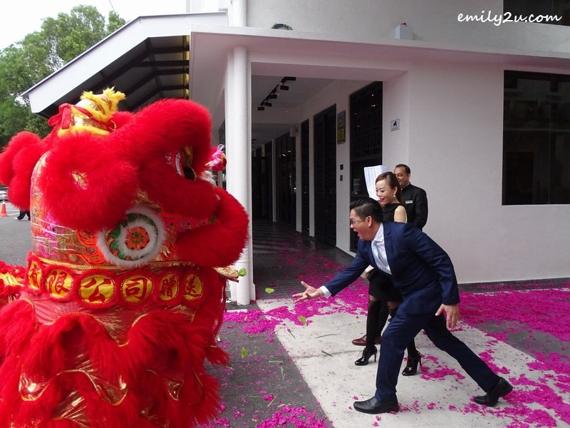 "7. Mr. Tony tries to catch the lettuce showered by the lion in a ""plucking the greens"" ritual (cai cheng)"