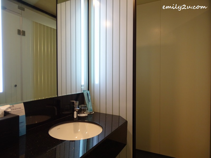 10. washroom with shower stall behind the partition