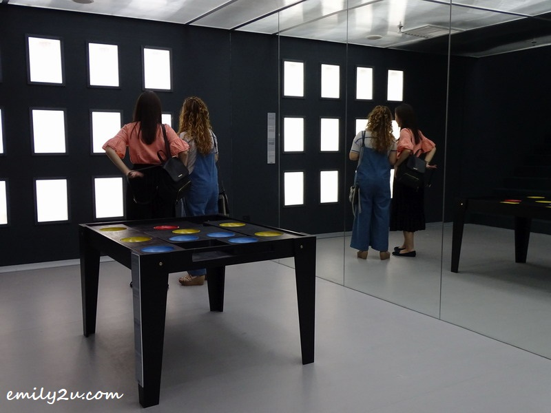 10. two visitors observe the Hollow Face Illusion