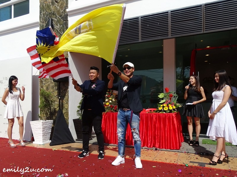 14. waving the flags of Malaysia and BAISI International
