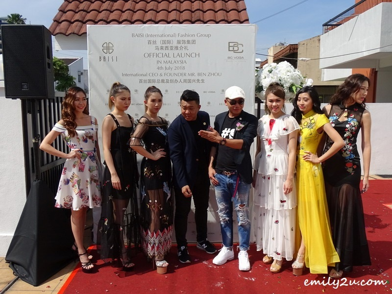 26. Mr. Ben Zhou & Mr. Christopher Chong pose with the six models