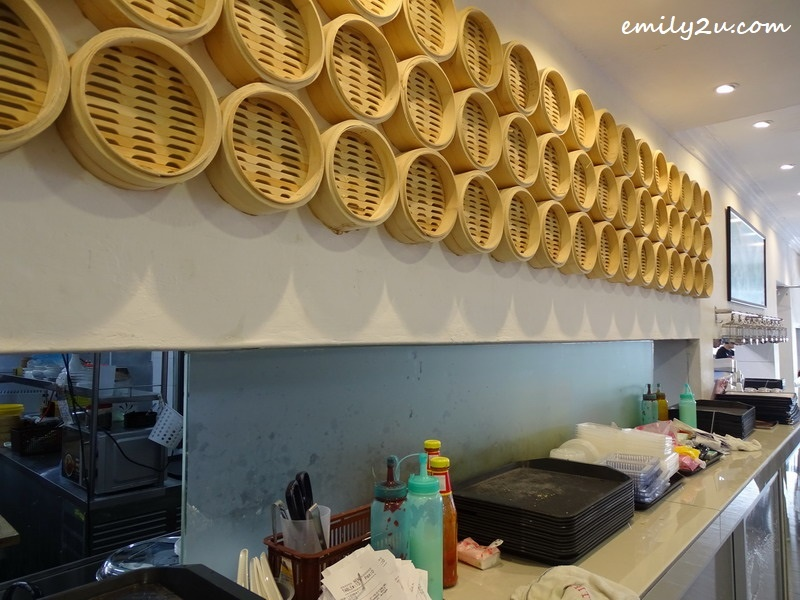 3. bamboo steamer baskets line the wall