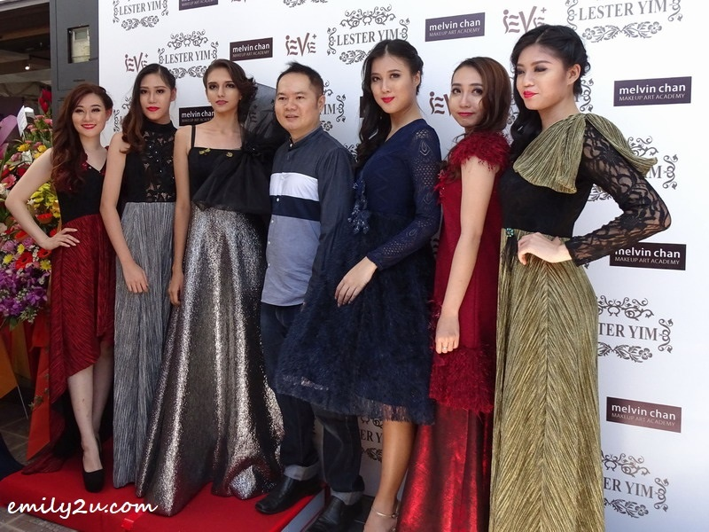 32. fashion designer with his models