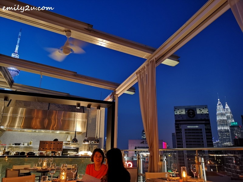 4. Cielo KL 希洛天空海鲜馆 rooftop restaurant with retractable roof, with views of the city's most famous landmarks: Petronas Twin Towers (R) and KL Tower (L)