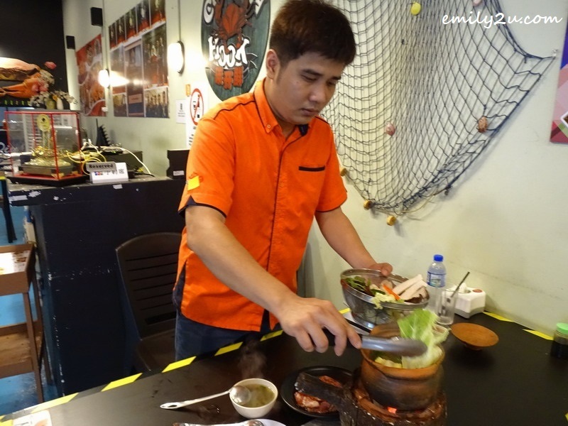 5. Chin adds ingredients into the Thai hot pot
