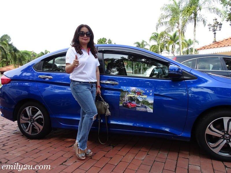 17. Ms. Maggie poses with Rosli's car