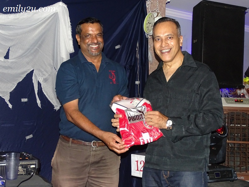 18. Louis Sebastian (R) with his limited edition Arsenal FC prize won in a lucky draw