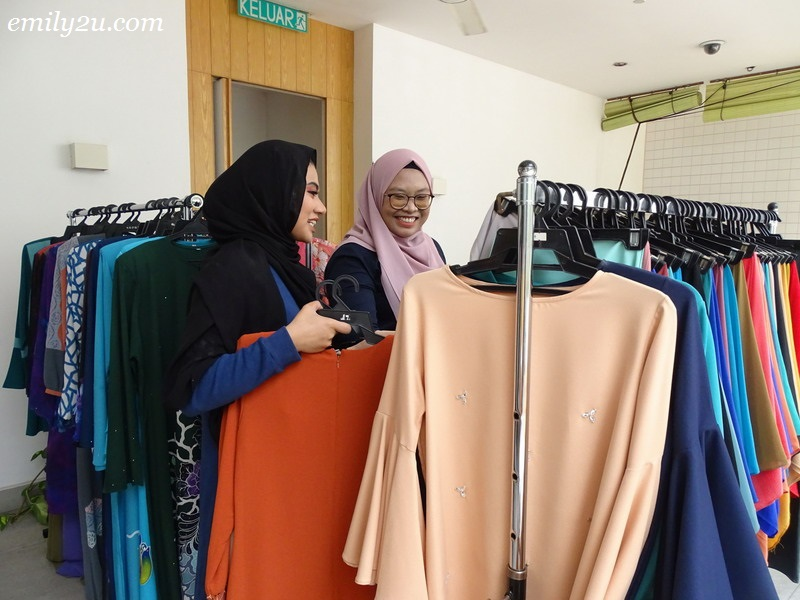 11. customers browsing through the apparel offered by Ektira