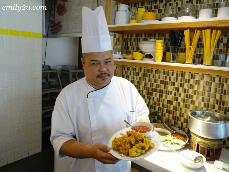 Executive Chef Nizam with a platter of signature cucur udang